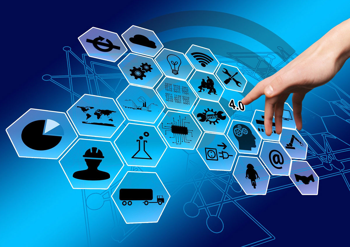 woman pointing towards icons related to IT/OT convergence and industry 4.0